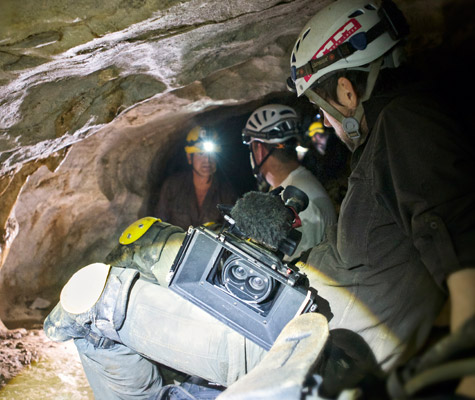 Crew filming caving
